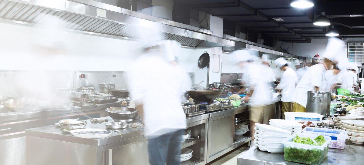 Commercial kitchen image showing chefs at work